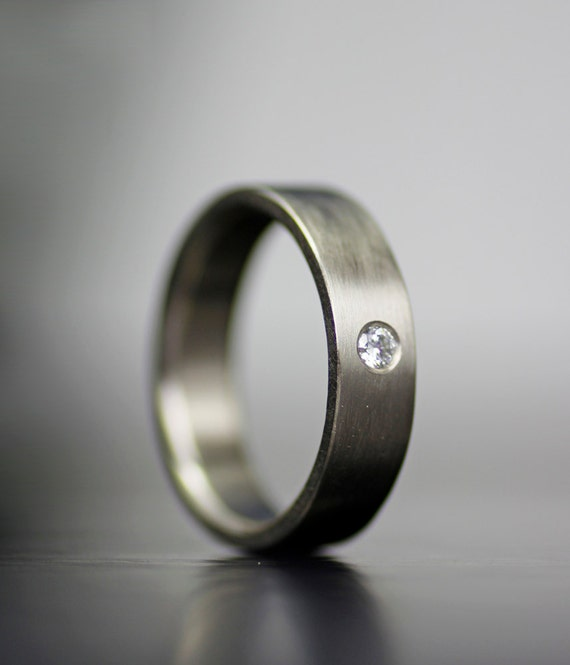 men s simple white gold wedding band with single stone