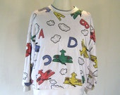 Puffy Cartoon Airplane Letter Sweater Top