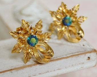 Vintage Clip-On Earrings in Gold Tone Metal with Blue Iridescent Stones