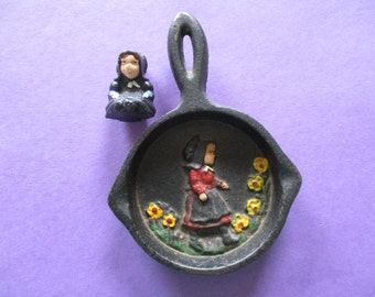 Vintage Miniature Cast Iron Black Fry Pan Skillet with Embossed Amish Girl and Small Cast Iron Amish Figurine