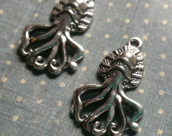 2pc. silver tone metal sqiuid charms