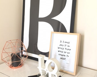 Large letter family initial Black and White with grid background