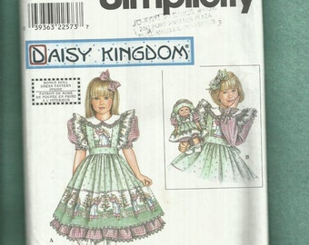 Simplicity 8553 Daisy Kingdom Ruffled Trimmed Pinafore & Puff Sleeve Dress for Girls and Baby Doll  Sizes 5..6..6x  UNCUT