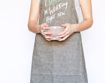 Organic Linen/Cotton Apron in Brown and Black Mix - Collaboration Print 'I Shoud be Working Right Now' in Teal