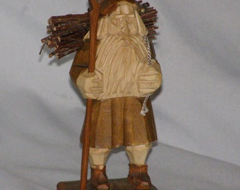 """Vintage German Gnome Zugspitz Kunstgewerbe with firewood for home. Stands 5.25"""" Circa 1970""""s"""