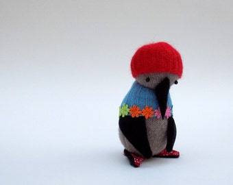 SALE - Grey Woollen Penguin  -  Handmade penguin wearing turquoise woolly cape with floral trim and red woollen hat.