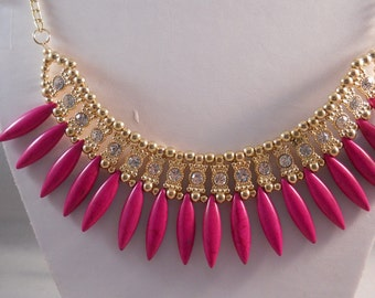 Gold Tone Bib Necklace with Purple Water Drop Beads and Clear Rhinestones on a Gold Tone chain