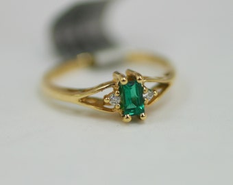 Elegant Emerald and Diamond Three Stone Promise Ring or Engagement Ring with an open cut design in 14 Karat Yellow Gold