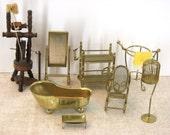 8 Pieces of Vintage Brass Doll Furniture: Doll Tub, Doll Mirror, Doll Bird Cage, Doll Rocking Chair, Doll Tea Cart, Doll Vanity
