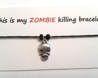A Zombie themed friendship bracelet on waxed cotton cord OR Silver Plated Key Ring OR Silver Plated Necklaces