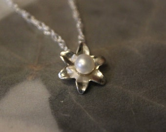 Sterling silver 925 freshwater pearl pendant with 16 Inch sterling rope chain. Delicate and one of a kind!
