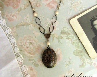 Oval Locket necklace in Antique bronze with Moroccan patterns ivory crystals and unusual handmade chain Two pictures keepsake vintage style