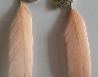 Lovely almond color feather earrings with a metal tree of life charm, dangling earrings