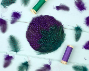 Purple and green feather headpiece, hair comb fascinator