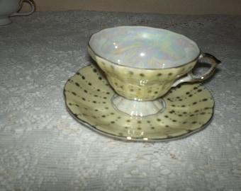 Porcelain Lustre-Ware Teacup and Saucer