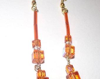 Swarovski Square Crystal Dangle Earrings In Reflective Orange.