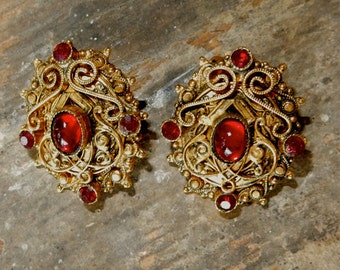 Vintage Costume Jewelry Clip Earrings. Signed Robert. Gold and Red Cabouchon Stones.