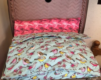 "Grey hardback suitcase pet bed with ""birdy"" fabrics"