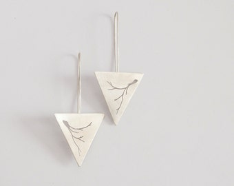 Long triangle earrings in sterling silver with hand sawed vegetal pattern. Organic and tribal at the same time!