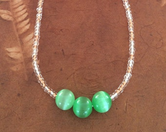 Beaded Necklace with Three ( 3 ) Iridescent Green Beads in the Front