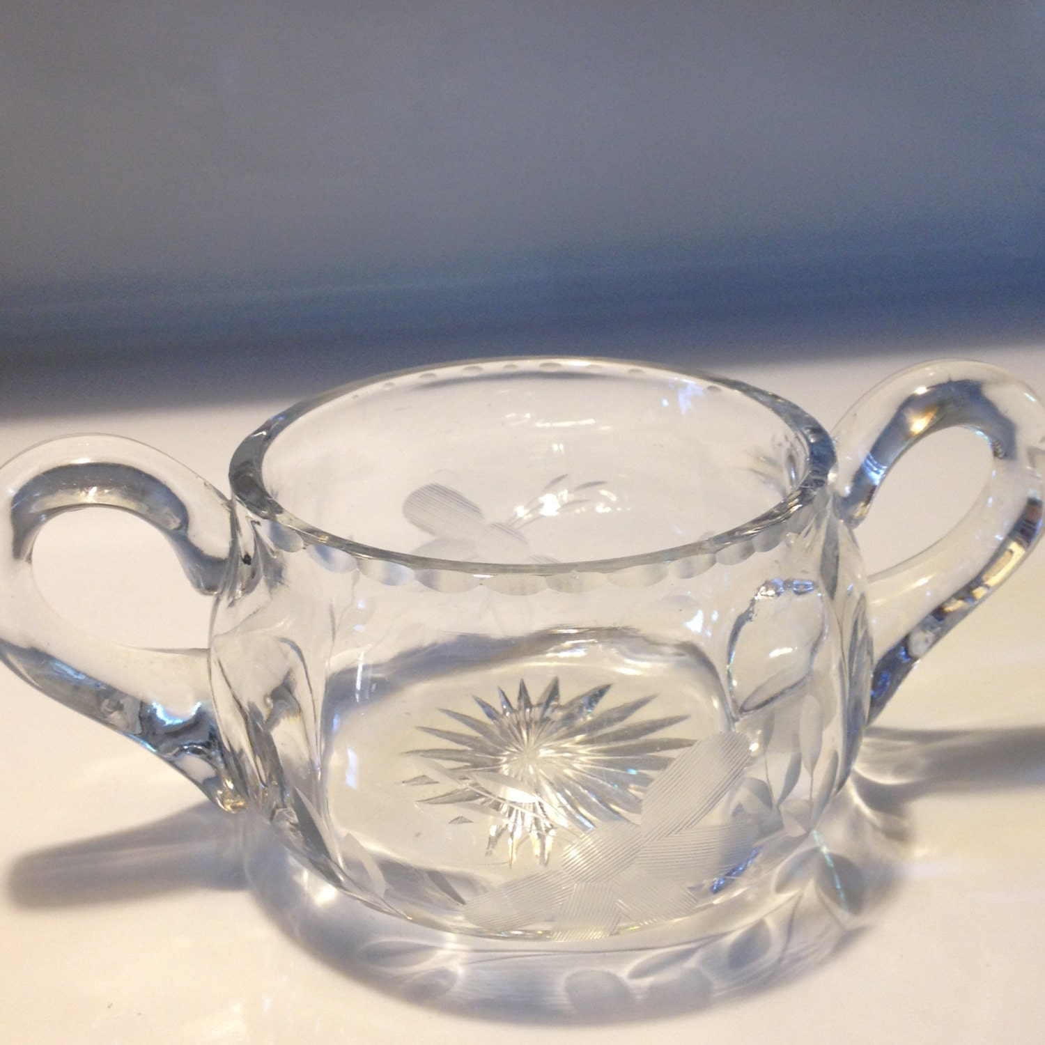 Double handled glass sugar bowl wheel cut daisy applied