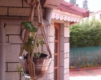 a jute macrame plant hanger / plant holder / pot holder /  bird feeder / small hanging planter indoor/ outdoor rope planter natural planter