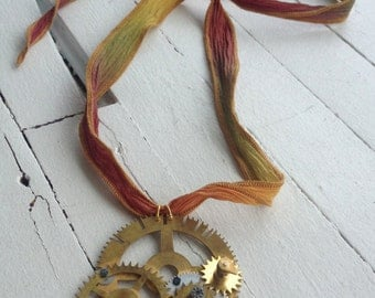 Necklace gears of recycled clocks on silk ribbon