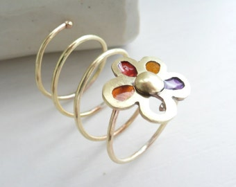 I wear a Flower Around  my Finger, 14 k gold, red, yellow, orange, purple resin by Stilosissima, California