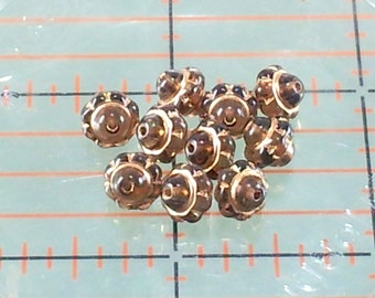 Czech Glass Dark Topaz Gold Saturn beads - Lot size 10