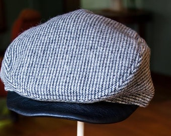 Childs black and white check driving cap with leather brim