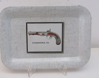 Small tin tray light grey with the design of a Derringer 48 - 1950s