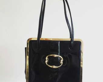 Black Hand Bag with Gold Clutch and Buckle