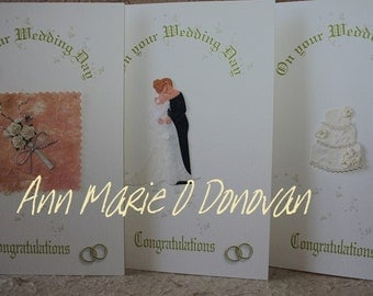 Stylish and elegant personalised Wedding card with beautiful  embellishment on a luxurious textured background.