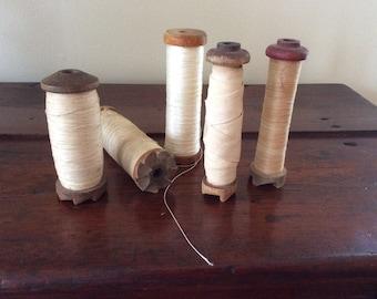Vintage industrial wooden thread spools
