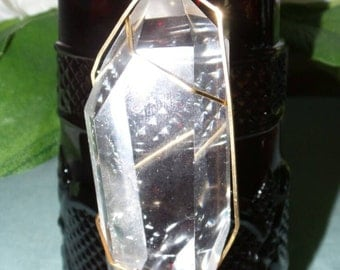 Quartz Crystal wrapped in 10k Gold.