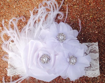 Adorable white lace, and chiffon flowers headband. Perfect for baptisms, christenings, or any occasion! Christmas outfits!