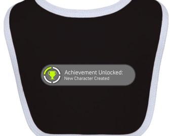 Achievement Unlocked: New Character Created Baby Bib by Inktastic