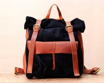 Suede/ Oiled leather roll backpack with pocket