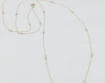 Long gold and silver necklace.