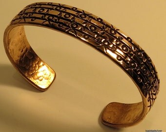 medium sized stylin stamped copper bracelet