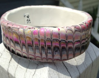 wide bangle , Peruvian fabric like.