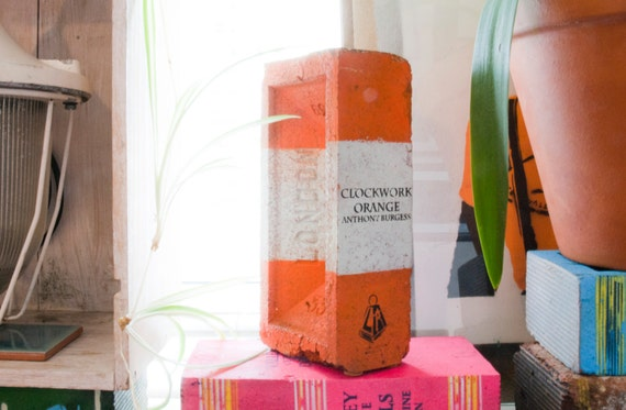 Painted Brick Book Clockwork Orange on Orange and White Brick