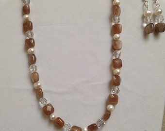 Sunstone, freshwater pearls and glass beads necklace and earrings.