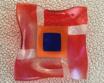Incredible iridescent orange with blue dichro fused glass square bowl, a wonderful decoration or great serving bowl.