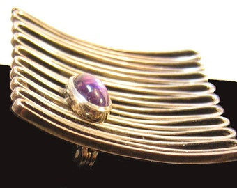 Sterling mid century ripple brooch with purple stone