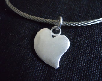 "Silver pendant heart ""The goodness"""