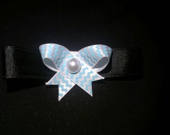 Black bow with wavy lines and pearl