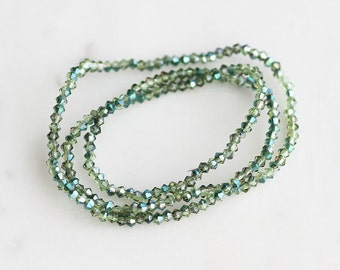 50% Off ENTIRE STORE // A2-618-10-02] Green Crystal / 2mm / Bicone Bead  / 1 strand