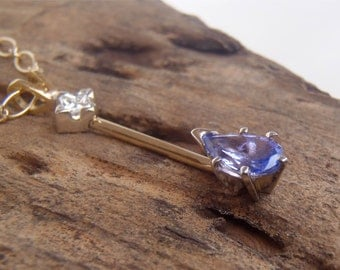 Modern Diamond and Tanzanite two-tone 14K White and Yellow Gold Pendant
