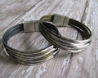 5 Strand Leather & Rhodium Sliding Curved Tubes Bracelet with Zamak Antique Silver Magnetic Clasp, Neutral Colors Available